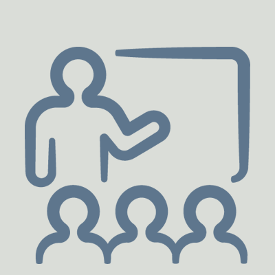 icon of stick figure standing at whiteboard in front of an audience